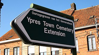 Ypres Town Commonwealth War Graves Commission Cemetery and Extension - Sign pointing to the extension