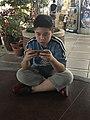 Sitting Boy Playing Samrtphone Game 20180323.jpg