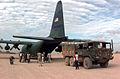 Somali cargo truck behind a US C-130.JPEG