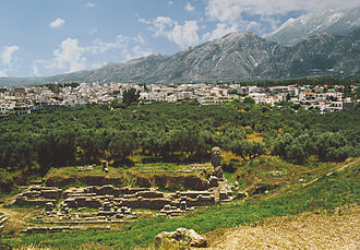 Laconia - The theater of ancient Sparta with modern Sparti and Taygetus in the background.