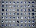 Square windows in gray facade (Unsplash).jpg