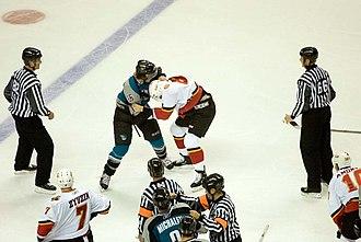 Steve Bernier - Bernier fighting Calgary Flames defenceman Brad Ference as a member of the Sharks