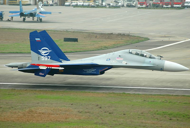 Sukhoi Su-30LL demonstrator flying along the runway at Zhangjiajie Hehua Airport less than 1 metre off the ground.jpg
