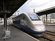 A TGV Duplex trainset coupled to a Reseau trainset leaving Paris Gare de Lyon.