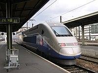 A TGV Duplex trainset coupled to a Reseau trainset leaving Paris Gare de Lyon.