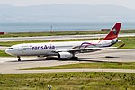 TNA A330-300 taxiing for R-W24L. (9393117192).jpg