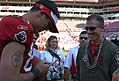 Tampa Bay Buccaneers wide receiver Joe Jurevicius autographs a game ball for Capt. Ryan Silver, a pilot from the 89th Flying Training Squadron at Sheppard Air Force Base, Texas.jpg