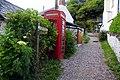 Telephone box on the Southwest Coast Path at Buck's Mills - geograph.org.uk - 1386994.jpg