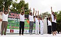 The Minister of State for Youth Affairs & Sports and Information & Broadcasting (IC), Col. Rajyavardhan Singh Rathore and other dignitaries participates in the mass yoga demonstration.JPG
