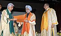 The Prime Minister, Dr. Manmohan Singh conferring Degree of Doctor of Science (Honoris Causa) to Shri Azim Premji, the Chairman, Wipro Limited, at the Golden Jubilee Convocation of IIT Bombay, in Mumbai on August 18, 2012.jpg