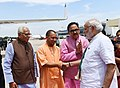 The Prime Minister, Shri Narendra Modi being seen off by the Governor of Uttar Pradesh, Shri Ram Naik and the Chief Minister of Uttar Pradesh, Yogi Adityanath, on his departure from Varanasi, Uttar Pradesh on July 15, 2018 (1).JPG