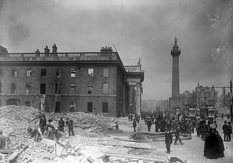 Damage in Dublin city centre following the 1916 Easter Rising with the ruins of the GPO to the left The shell of the G.P.O. on Sackville Street after the Easter Rising (6937669789).jpg