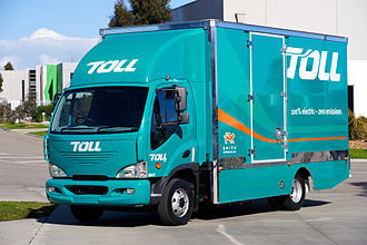 Toll Domestic Forwarding - Toll's 10-tonne electric truck by Smith Electric. It has a range of up to 200km and a top speed 95km/h. It runs on a lithium-ion 80kW battery, requires 5-6 hours overnight charge, and is zero-emission.