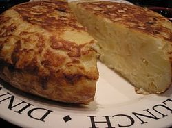 Tortilla de patatas cut in half.