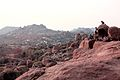 Tourists on a cliff at Hampi.jpg