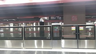 Pink Line (Delhi Metro) - Image: Train in station (Netaji Subhash Place) of the DMRC pink line network