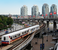 TransLink SkyTrain departs Stadium-Chinatown station in Vancouver, British Columbia, Canada.png