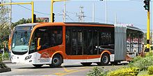 Orange-and-white articulated bus