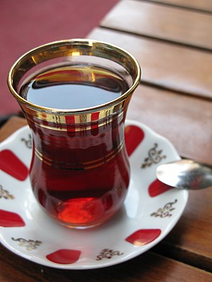 Tea in Turkey - Turkish tea served in the typical manner, in a glass on a small saucer