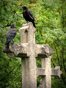 Two birds on a cross - Pere Lachaise.jpg