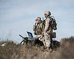 U.S. Marine Corps Capt. Erich Lloyd, right, a joint terminal attack controller with the 1st Air Naval Gunfire Liaison Company, and a German Air Force JTAC work a close-air support mission at Mountain Home Air 131002-F-WU507-212.jpg