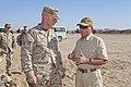 U.S. Marine Corps Maj. Gen. John A. Toolan, commander, Regional Command (Southwest), speaks with his training advisor, Terry Walker at the O'Brian range aboard Camp Leatherneck, Afghanistan, Sept 110924-M-LU710-037.jpg