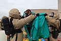 U.S. Marine Corps chemical, biological, radiological and nuclear (CBRN) defense specialists with Marine Wing Headquarters Squadron (MWHS) 3, 3rd Marine Aircraft Wing, perform decontamination procedures during 130430-M-EF955-271.jpg