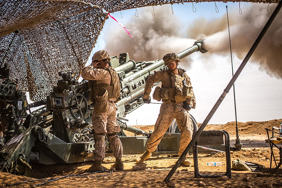 U.S. Marines with the 11th Marine Expeditionary Unit fire an M777 Howitzer during a fire mission in northern Syria as part of Operation Inherent Resolve, Mar. 24, 2017