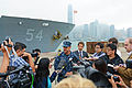 U.S. Navy Capt. Tom Disy, center, the commanding officer of the guided missile cruiser USS Antietam (CG 54), speaks to reporters in Hong Kong Nov. 12, 2013, about the ship and the George Washington Carrier 131112-N-TG831-094.jpg