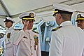 U.S. Navy Cmdr. James R. Kenny, center left, the outgoing commanding officer of the guided missile destroyer USS Donald Cook (DDG 75), salutes Cmdr. Scott A. Jones, center right, the incoming commanding officer 130510-N-KE519-064.jpg