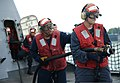 U.S. Navy Gunner's Mate 1st Class James Poole, front, and Chief Damage Controlman Corey Williams, rear, assigned to the littoral combat ship USS Freedom (LCS 1), advance on a simulated fire during an 130523-N-PD773-023.jpg