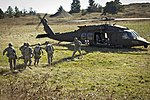 U.S. Soldiers with Bravo Company, 1st Battalion, 186th Infantry Regiment, Oregon Army National Guard, carry a simulated casualty aboard a UH-60 Black Hawk medical evacuation helicopter assigned to Charlie 130309-Z-ZZ999-001.jpg
