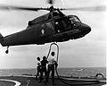 UH-2 Seasprite HC-7 being refueled from ship off Vietnam c1970.jpeg