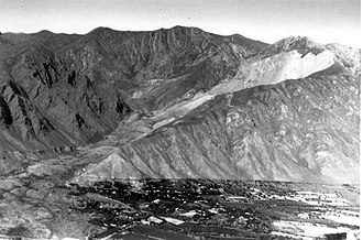 1949 Khait earthquake - View of the Khait landslide showing the scar on Chokrak mountain and the landslide that overwhelmed the village of Khait