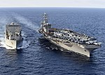 USS Dwight D. Eisenhower conducts a replenishment-at-sea with USNS William McLean (25530952203).jpg