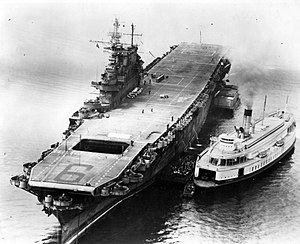 SS Asbury Park - The aircraft carrier USS ''Enterprise'' unloading her sailors onto the City of Sacramento at the Puget Sound Navy Yard in June 1945. This was right after the aircraft carrier was nearly destroyed by a kamikaze encounter a month earlier off Okinawa.