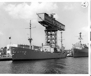 USS Georgetown (AG-165) - USS Georgetown (AGTR-2) moored pierside under the hammerhead crane at Norfolk Naval Shipyard, Portsmouth, VA. in October 1966