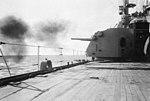 USS Newport News (CA-148) firing 127 mm artillery off Puerto Rico in 1966.jpg