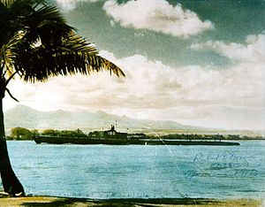 Pollack (SS-180) entering Pearl Harbor, c. 1943-44.
