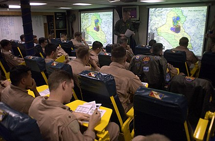 Carrier Air Wing Two (CVW-2) mission briefing aboard Constellation (CV-64), 21 March 2003. US Navy 030321-N-4142G-020 Pilots assigned to Carrier Air Wing Two (CVW-2) listen to a pre-flight brief in one of the squadron ready rooms aboard USS Constellation (CV 64).jpg