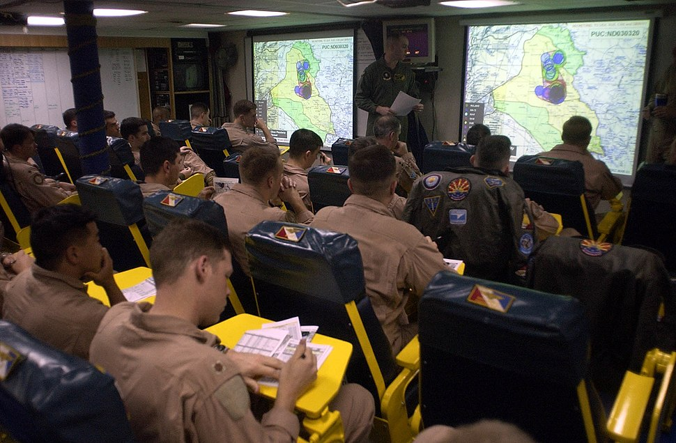 US Navy 030321-N-4142G-020 Pilots assigned to Carrier Air Wing Two (CVW-2) listen to a pre-flight brief in one of the squadron ready rooms aboard USS Constellation (CV 64)