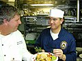US Navy 030430-N-4518L-002 Mess Management Specialist Seaman Brandon Martinez, from Wellsville, Kan., and celebrity chef Chris Nealson.jpg