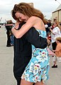 US Navy 030501-N-2069B-002 A pilot from Strike Fighter Squadron One One Five (VFA-115) is greeted by his wife upon his return to Naval Air Station Lemoore.jpg