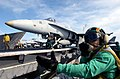 US Navy 030522-N-4953E-006 An Aviation Boatswain's Mate stands the Deck Edge Safety watch, ensuring that the flight deck is all clear for an F-A-18 Hornet preparing to launch from one of four steam powered catapults aboard USS.jpg