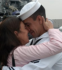 US Navy 040603-N-4304S-039 Hospital Corpsman 1st Class Mario Martin, embraces his fiancée after a successful marriage proposal.jpg