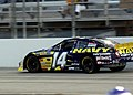 US Navy 040626-N-5576W-012 The No. 14 Navy Chevy Monte Carlo, driven by Casey Atwood, races around the Milwaukee Mile Speedway during the Alan Kulwicki 250 Busch Series race.jpg