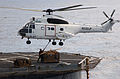 US Navy 040717-N-2805L-115 An SA330J Puma helicopter assigned to the Military Sealift Command fast combat support ship USNS Spica (T-AFS 9) picks up cargo to be delivered to the USS Harry S. Truman (CVN 75).jpg