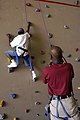 US Navy 040727-N-0683J-010 Yeoman 1st Class Juan Piper assists his son up the rock-wall at the Smoky Point Naval Support Complex during the first phase of the Drug Education for Youth (DEFY) Program.jpg
