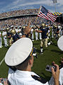 US Navy 040925-N-9693M-001 U.S. Naval Academy Midshipman cheer as their football team runs onto the field prior to a game against Vanderbilt.jpg