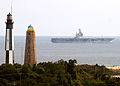 US Navy 041102-N-0318R-001 The Nimitz-class aircraft carrier USS George Washington (CVN 73) passes the Fort Story Lighthouse shortly after getting underway from Norfolk Naval Station, Va.jpg